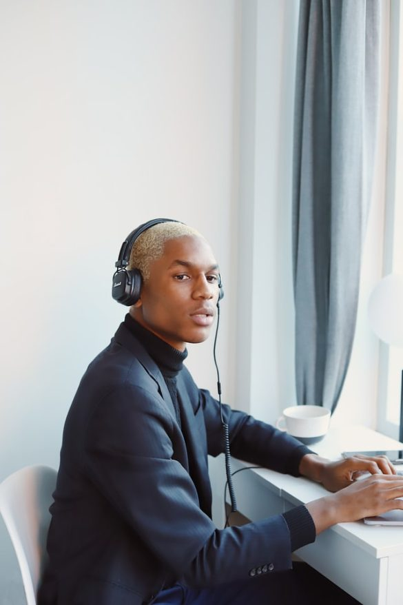 An African American male with wearing headphones